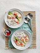 Pho (soup with rice noodles, salmon, vegetables and chili, Vietnam)