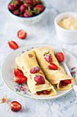 Crepes with vanilla cream and fresh strawberries