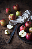 Apples on a dark wooden surface