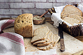 Wholewheat bread on a chopping board and in a bread basket
