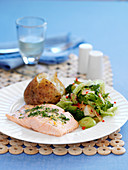 Baked salmon with a baked potato and vegetables