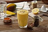 A turmeric and mango shake with chia seeds