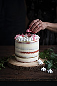 Cranberry vanilla layer cake with a meringue wreath