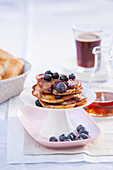 Blueberry pancakes with lemon and maple syrup