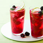Two glasses of Blackberry Lime Rickey cocktails