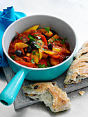 Pepper and tomato stew with potatoes and olives (Spain)