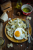 Farfalle with a fried egg, herbs and Parmesan