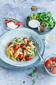 Penne with tomatoes and rocket