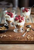 Limoncello cream with nutcrumble and raspberries