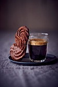 Chocolate piped biscuits with a glass of coffee