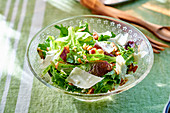 Young mixed leaf salad with shaved cheese
