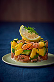 Salmon timbale with mango and courgette