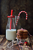 Christmas gingerbreads with a bottle of milk