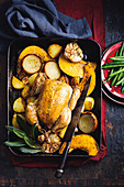 Slow roasted garlic chicken and vegetables