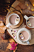Melting marshmallow snowmen in hot chocolate