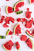 Watermelon pieces, some with bites taken out (seen from above)