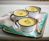 Cream of corn soup in enamel cups