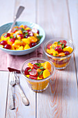 Fruit salad with peach, grapes, tangerines and mint