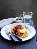 Salmon with a soy and ginger glaze on egg noodles