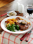 Sirloin steak with herb butter and french fries