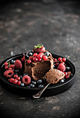 Chocolate mousse with olive oil and various berries
