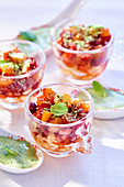 Fruit salad with pistachio nuts and basil sauce