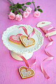 Colourful heart-shaped biscuits on a cake stand