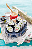 Maki sushi with surimi, cucumber, avocado, ginger, wasabi and soy sauce