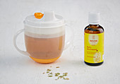 Fennel tea in a sippy cup with tummy oil