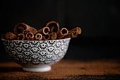A bowl of cinnamon sticks