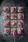 Wholemeal crackers with a vegan beetroot and cashew nut spread