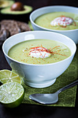 Vegan cream of avocado soup with limes and chillis