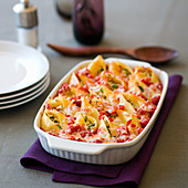 Shell pasta with a cheese and vegetable filling in a baking dish