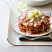 A stack of enchiladas with minced meat, beans and cheese (Mexico)