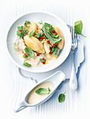 Semolina dumplings with broccoli and taleggio cheese