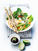 Green Thai vegetables with coconut and rice noodles
