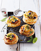 Mini pizzas with tomatoes and olives