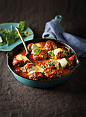 Italian meatballs with tomatoes and basil