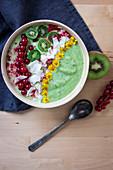 Green smoothie bowl with kiwi