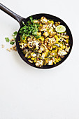Spicy millet pilau with roasted cauliflower and paneer cheese