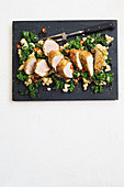 Breaded pork with kale, lemons and cannellini