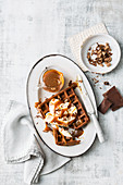 Chocolate waffles with vanilla and caramel sauce