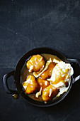 Salted caramel dumplings with vanilla sauce and ice cream
