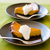 Two slices of pumpkin pie with whipped cream