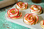 Apple roses in puff pastry in a muffin tin (unbaked)