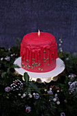 A Christmas dripping candle cake