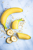 A whole banana and a sliced banana with oats