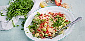 Couscous salad with avocado, rocket and pepper
