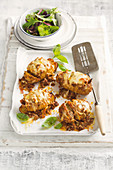 Hasselback potatoes with bolognese sauce