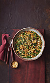 Freekeh with spinach, cinnamon, raisins and pine nuts (Lebanon)